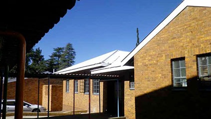 Exterior of J.P. Greyling school. Roofs renovated by Ferrero.